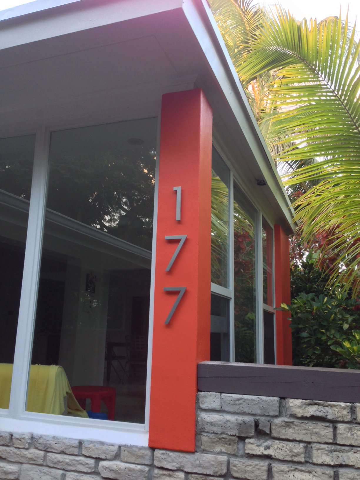 Modern house numbers on orange post